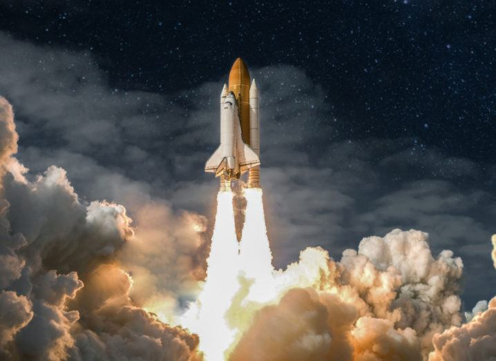 Composite image depicting a rocket blasting off, carrying a spacecraft past large cumulus clouds and into space.
