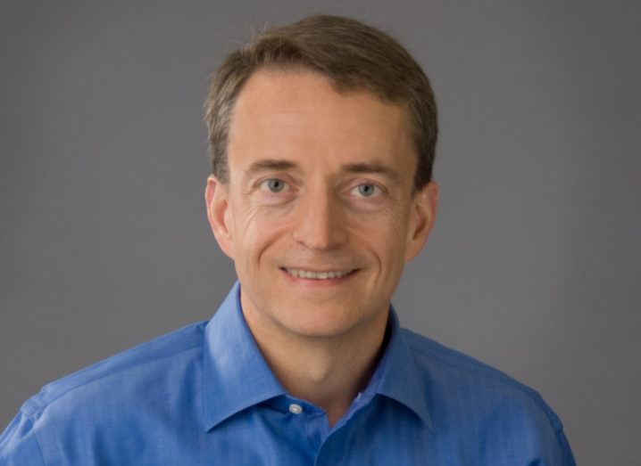 A headshot of Pat Gelsinger in a blue shirt against a grey background.