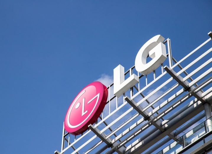 LG logo on a building under a blue sky.