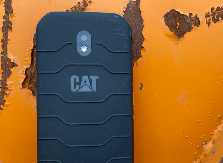 The rear of a rugged smartphone with a textured grip, bearing the Cat logo.