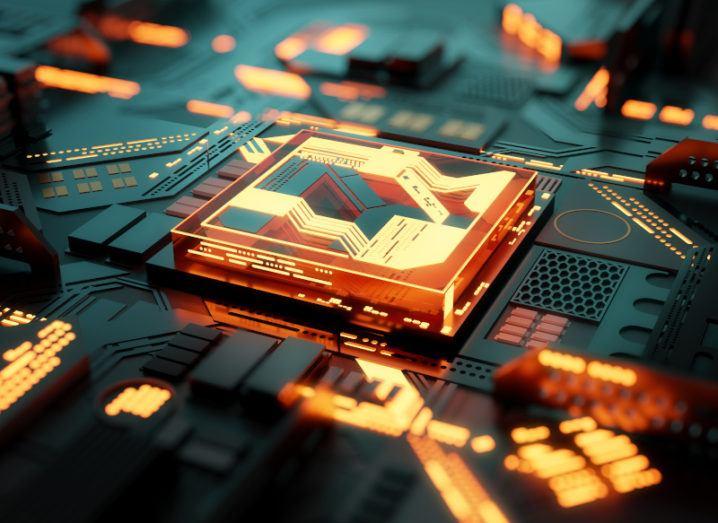 Futuristic central processing unit with orange lights on it, representing quantum computing.