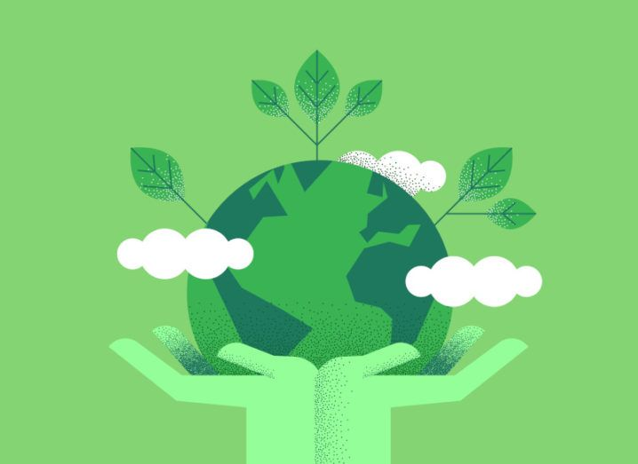 Illustration of green hands holding up planet Earth against a green background, symbolising sustainability.