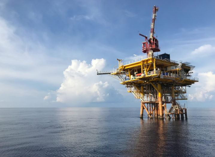 Photo of oil and gas extraction machinery in an ocean.