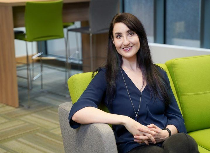 Dr Shawna Johnston of TU Dublin sits on a green sofa.