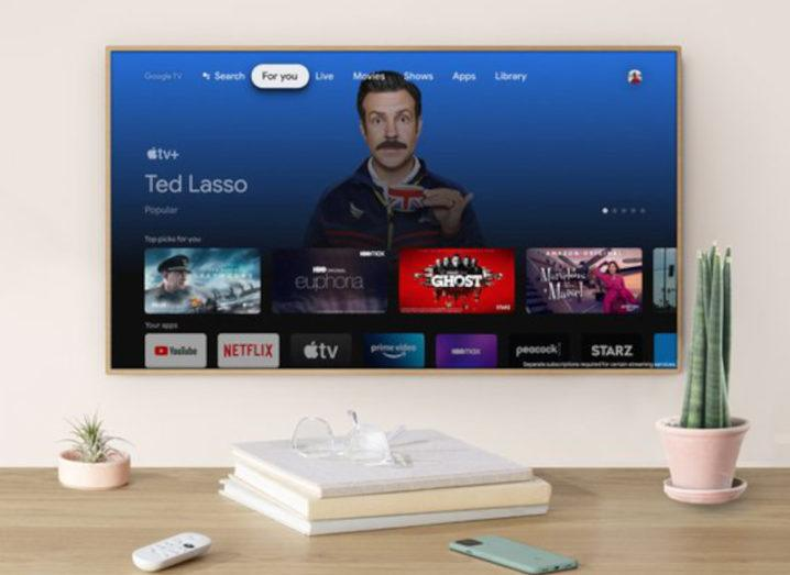 The AppleTV+ interface on Google TV on a widescreen television.