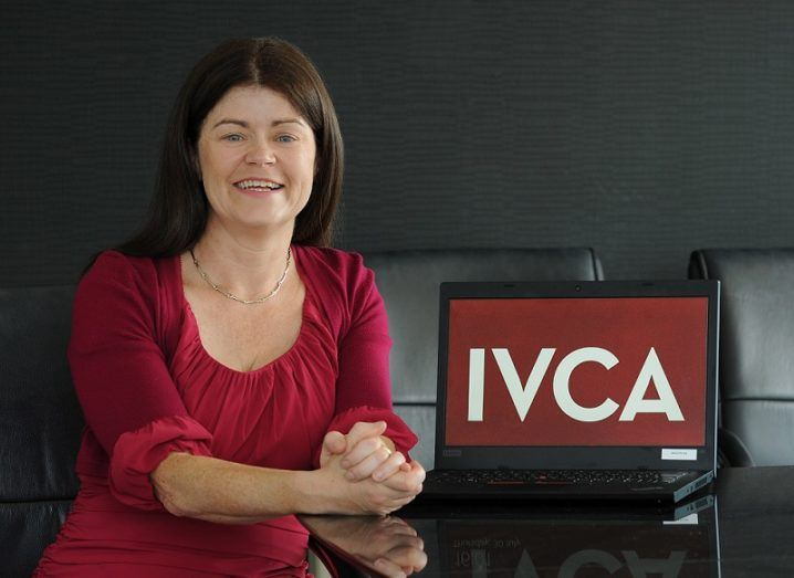 Gillian Buckley sits at a desk beside a laptop that says IVCA on the screen.