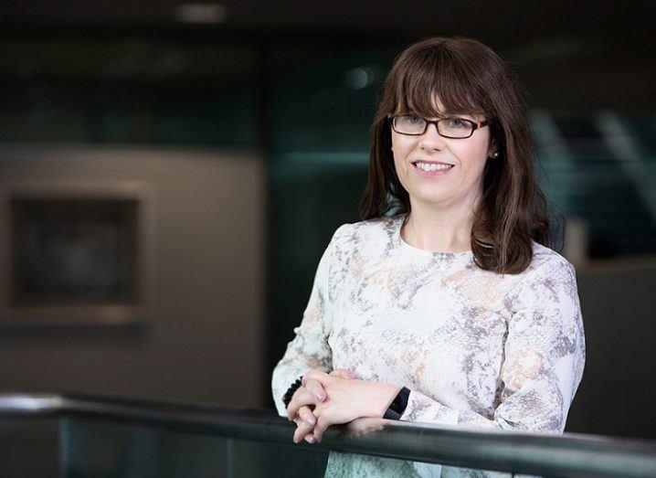 Jenny Melia of Enterprise Ireland stands against a railing.