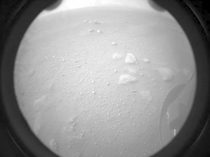 Image from a Perseverance camera, showing a rocky surface.