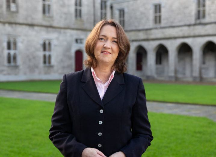 Prof Máire Connolly of NUI Galway, wearing a black jacket, standing outside on the grounds of the university.
