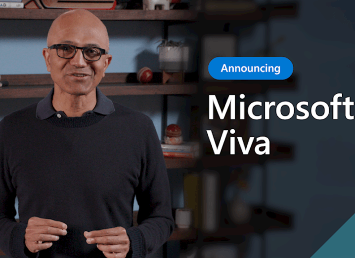 Microsoft CEO Satya Nadella stands in an office. Beside him his text that says 'Introducing Microsoft Viva'.