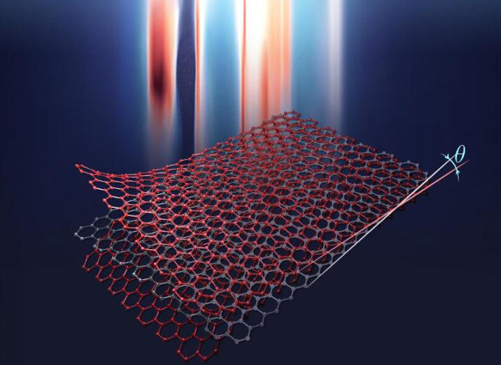 An artist's rendering of a twisted trilayer graphene structure, which looks like three red lattice squares layered on top of each other.