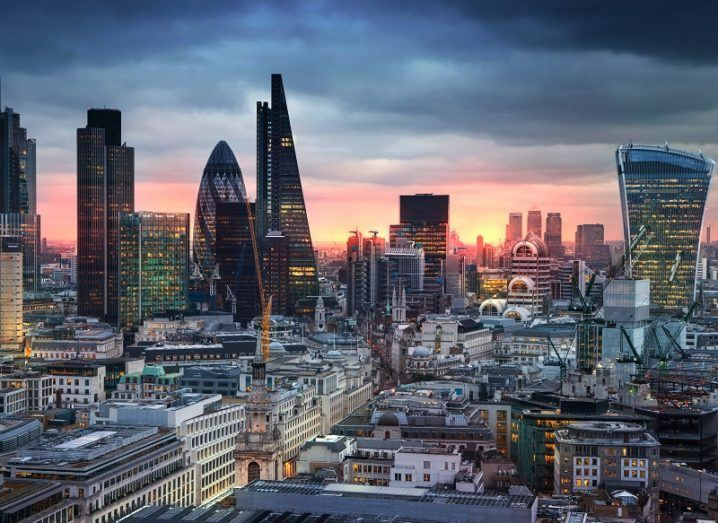 A view over the London city skyline at dusk.