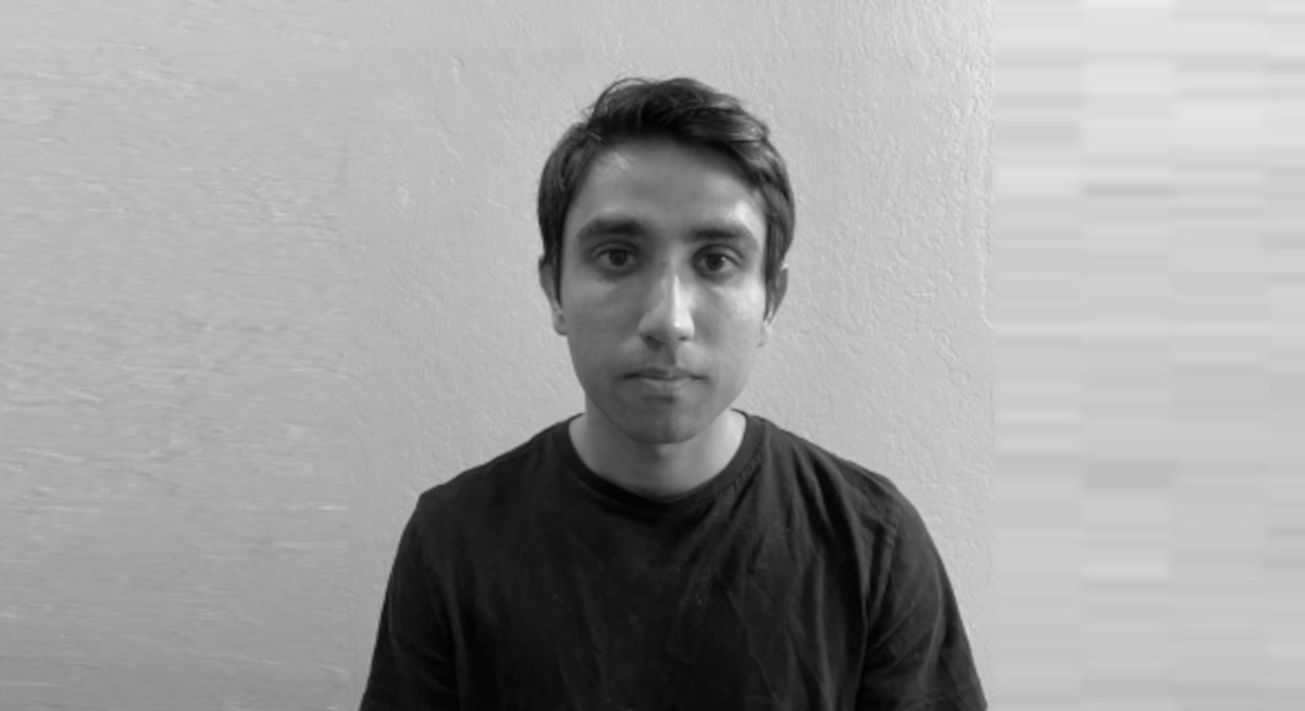 A black and white photograph of Siddharth Rao of Twitter.