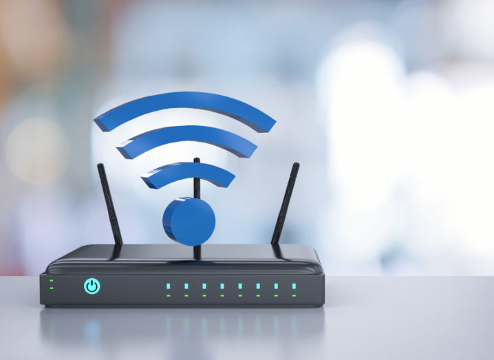 A Wi-Fi router with a Wi-Fi symbol over it.