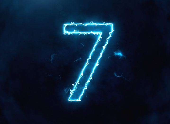 A large number seven is highlighted in electric blue lighting against a dark background.
