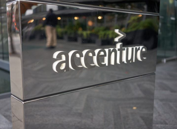 A silver company sign for Accenture.
