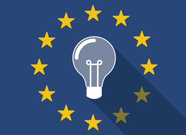 A graphic image of a lightbulb in the middle of a ring of gold stars, resembling the EU flag.