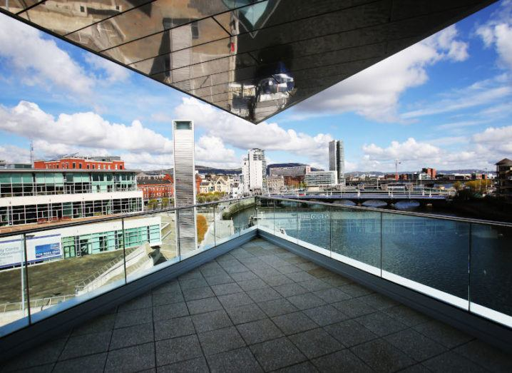 A shot of Belfast City from a modern balcony on a sunny day, where the MIT tech conference will take place.