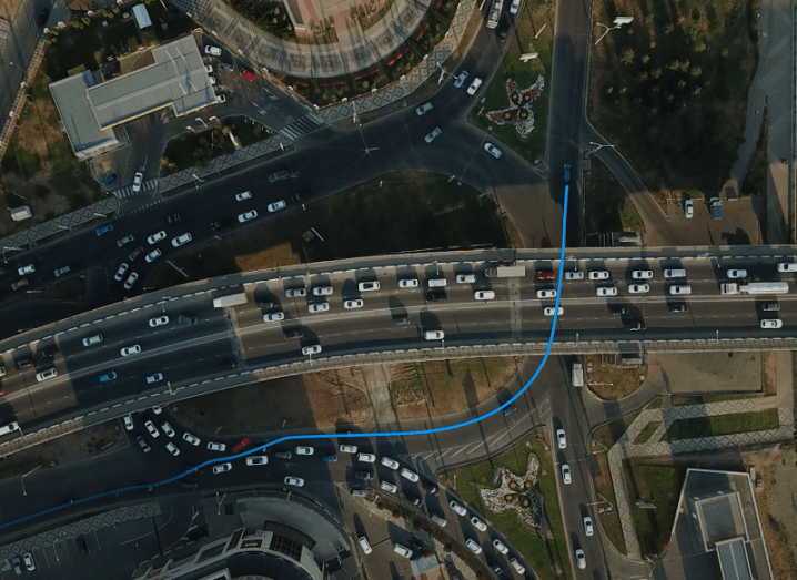 GPS system tracking a car on a busy highway.
