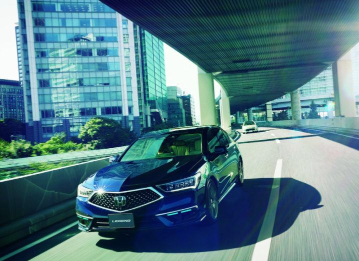 Photo of the Honda self-driving car on a highway in Japan.