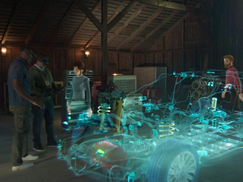A virtual image of people gathered together around a vehicle.