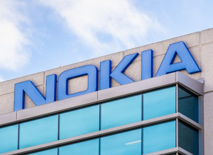 The top of an office building with the blue Nokia logo spelled out.