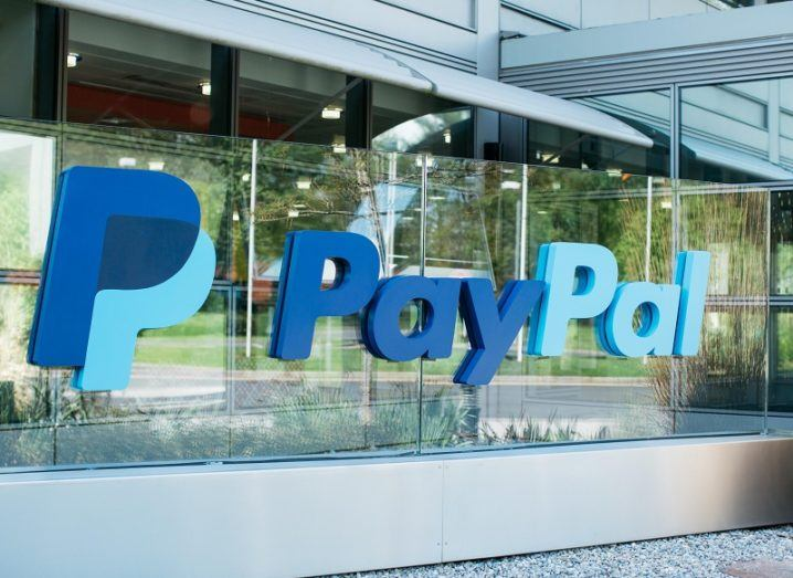 PayPal's Dublin offices with its large blue logo on a glass wall.