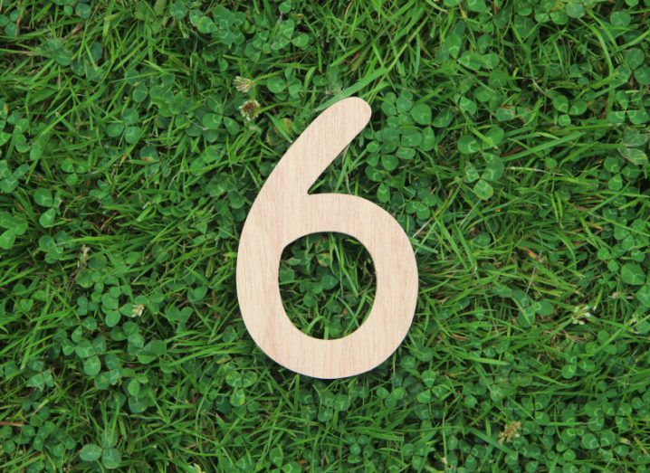 Wooden number six lying on a bed of grass to symbolise the six tips for getting funding.