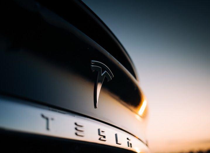 Tesla logo the back of a car.