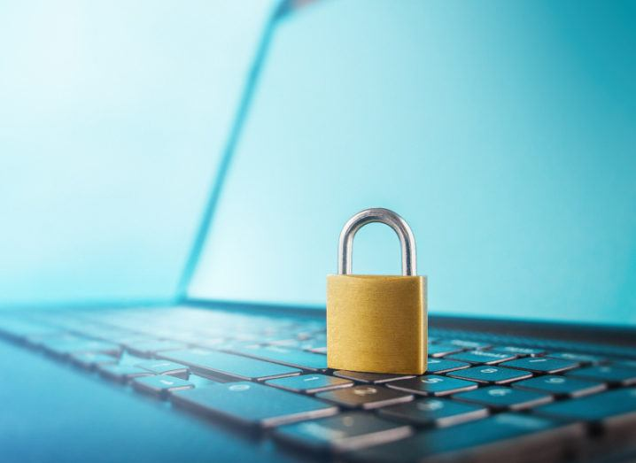 A padlock is resting on a computer keyboard, symbolising cybersecurity.