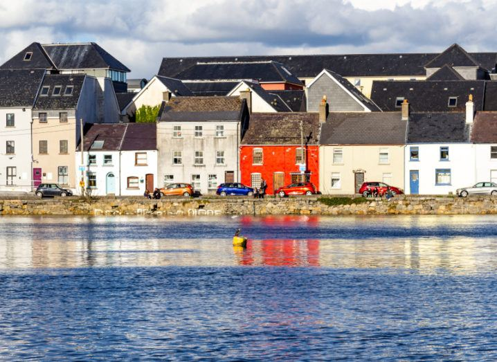 Panorama of Galway city with village houses and Corrib river.