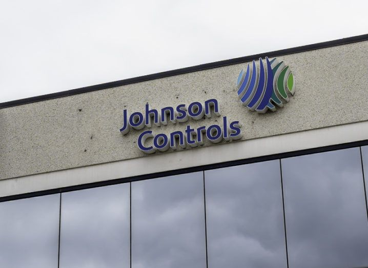 Building with Johnson Controls signage against a cloudy sky.
