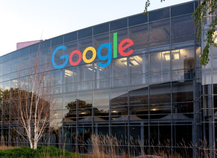 A large glass building bearing the Google logo at its headquarters in Mountain View, San Francisco.