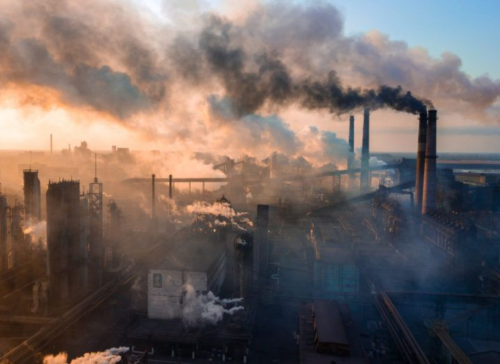Aerial view of a large industry plant with several plumes of smoke polluting the air with CO2 emissions.