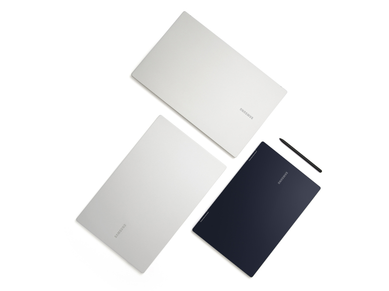 Three Samsung Galaxy Book laptops, two silver and one blue, are lying against a white background.