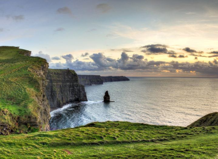 Panoramic view of the Cliffs of Moher at sunset in Ireland.