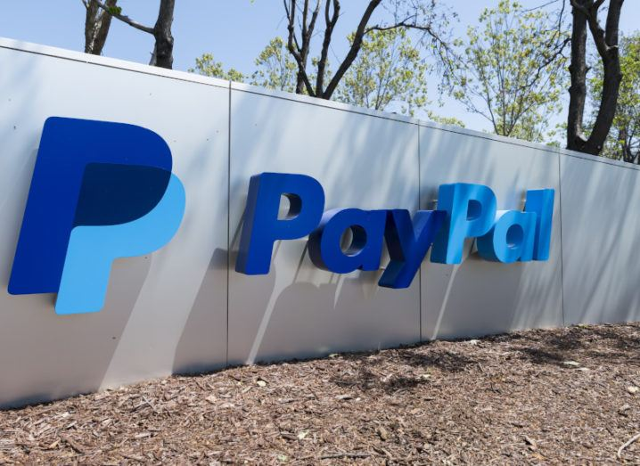 A large PayPal logo on a sign close to the ground on a sunny day.