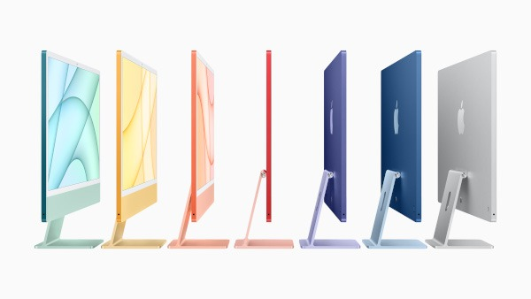 Seven iMacs from a side profile in a variety of colours.