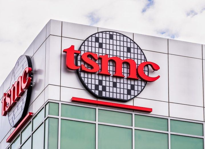 TSMC factory building with a large company logo on the side of it.