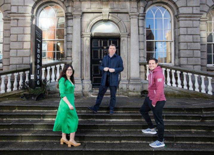 Three people stand socially distanced on the steps of the Powerscourt Centre in Dublin city.