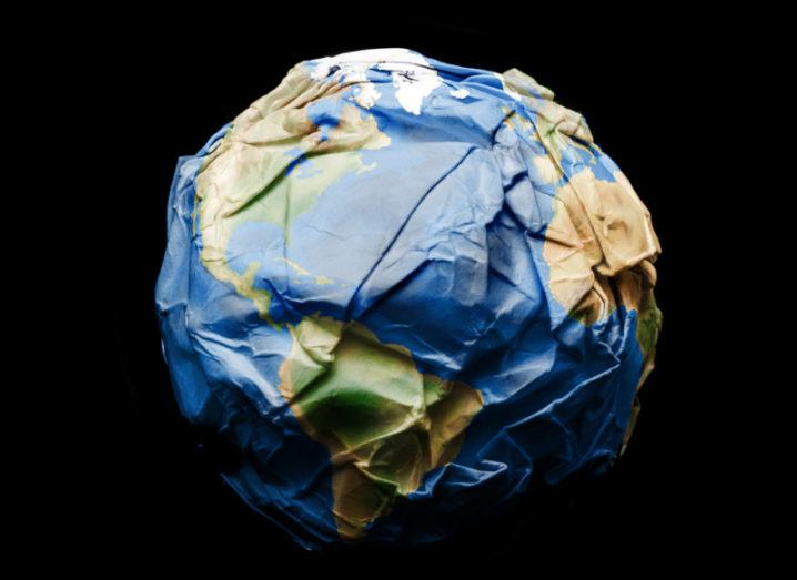 A model of Earth using crumpled up paper.