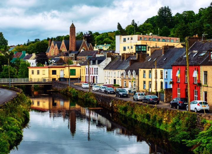 A town landscape in Donegal, with a river and colourful buildings.