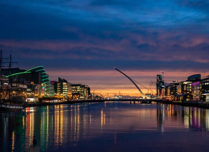 A cityscape image of the River Liffey in Dublin at dusk.