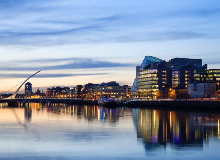 A landscape image of Dublin City and the River Liffey at sunset with the Samuel Beckett Bridge in the background.