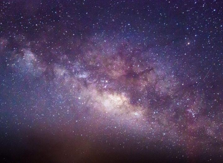 A purple-blue sky full of stars, depicting the galaxy.