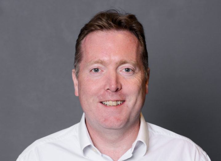 A headshot of Peter Ingram, CTO of Hastee. He's wearing a shirt and smiling at the camera.