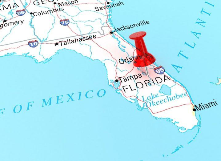 A map with a pin in the US state of Florida.