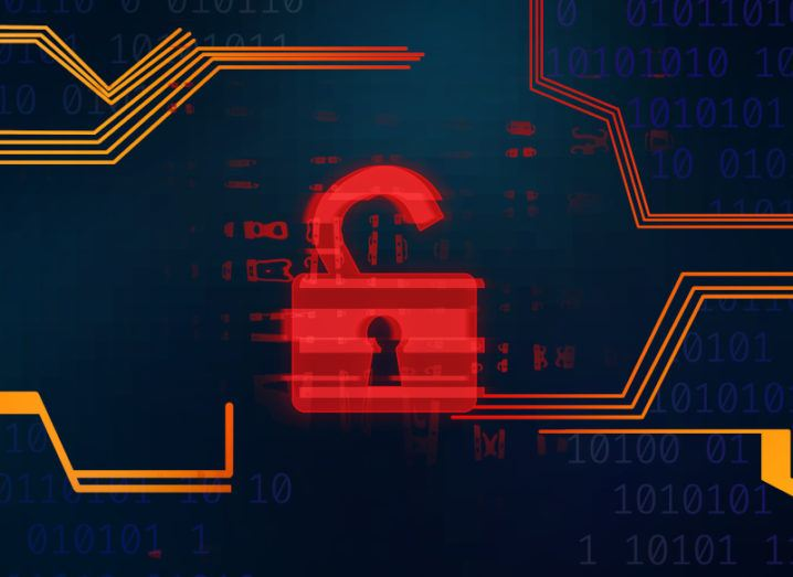 A red pixelated digital open padlock against a navy background with code.
