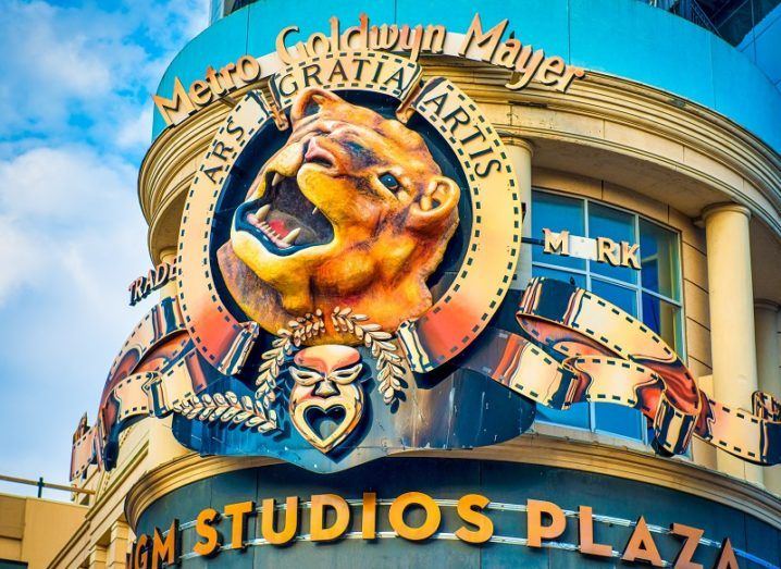 The MGM logo, featuring a large lion, on the side of a building.