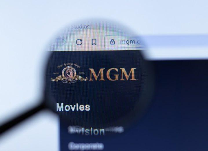 A magnifying glass is highlighting the MGM logo on a website.